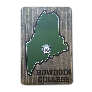 Wood-look refrigerator magnet with a small Bowdoin polar bear mascot medallion within a green stylized State of Maine imprint. The words BOWDOIN COLLEGE are printed in black in the bottom corner.