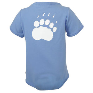 The back of a blue diaper shirt showing a large polar bear paw print in white.