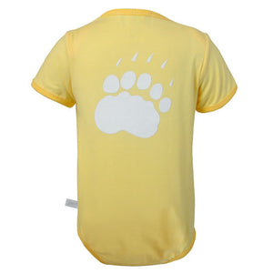 The back of a yellow diaper shirt showing a large polar bear paw print in white.