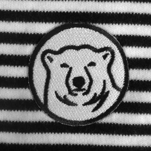 Closeup detail of black and white embroidered mascot medallion patch.