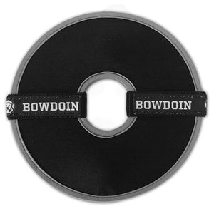 Round black flying disc toy with center cutout. Grey trim on inside, black ribbon with repeating BOWDOIN and mascot medallion sewn to nylon webbing decoration across each half of the disc.