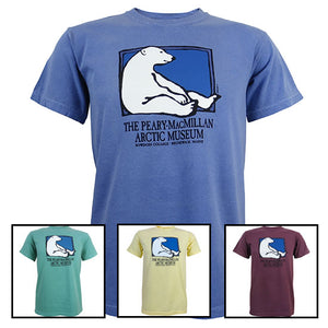 Four different colors of Peary-MacMillan Arctic Museum T-shirts