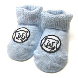 Blue baby socks with embroidered mascot medallion patch on top of foot.