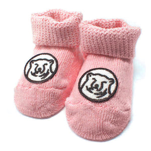 Pink baby socks with embroidered mascot medallion patch on top of foot.