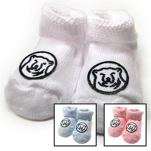 Montage of Bowdoin baby socks in white, blue, and pink.