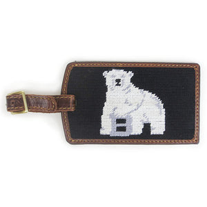 Brown leather luggage tag with brass buckle and needlepointed Bowdoin polar bear mascot backing.