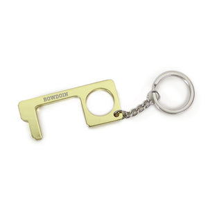 Hook shaped metal key tag with engraved BOWDOIN across top.