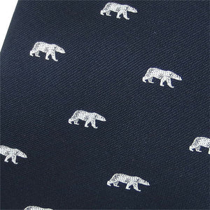 Closeup of woven polar bear design on navy blue necktie.