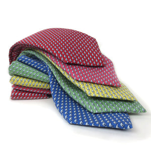 Stack of 5 silk ties in red, raspberry, yellow, green, and blue.
