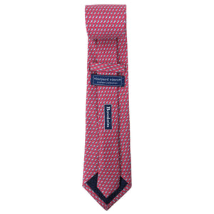 Back view of a raspberry silk tie with an all-over imprint of the Hyde Plaza polar bear showing Vineyard Vines label and Bowdoin wordmark.