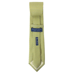 Back view of a yellow silk tie with an all-over imprint of the Hyde Plaza polar bear showing Vineyard Vines label and Bowdoin wordmark.