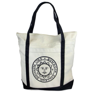 Natural canvas tote with black handles and bottom. Bowdoin sun seal imprint on front pocket.