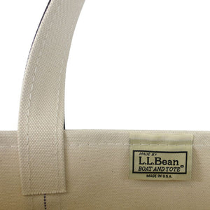 A closeup shot of the L.L.Bean patch on the inside of a canvas tote bag.