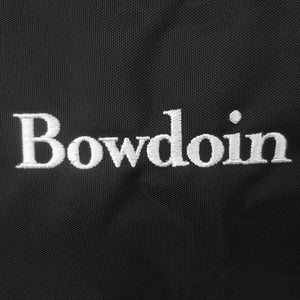 Detail showing quality of white Bowdoin wordmark embroidery.