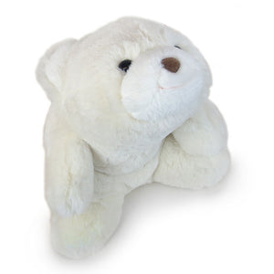 Stuffed white plush polar bear in a sitting position.