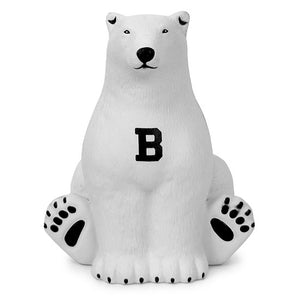 White polar bear sitting upright with black B on chest.