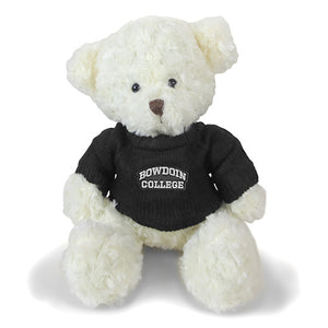 Ivory sitting teddy bear in black knit sweater with BOWDOIN COLLEGE patch on chest.