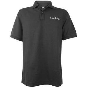 Black polo shirt with white embroidered Bowdoin wordmark on left chest.