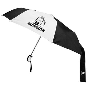 Umbrella with alternating black and white panels. Center white panel has imprint of polar bear mascot over the word BOWDOIN. Black closure band has same imprint on it.