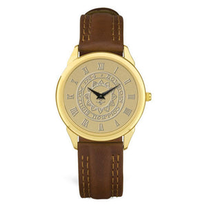 Gold wrist watch with brown leather strap. Face is engraved wth Bowdoin sun seal.