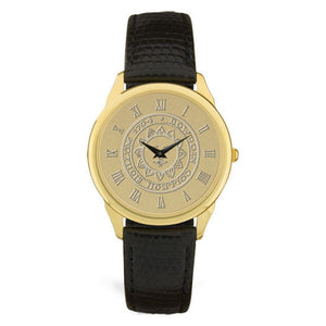 Gold wrist watch with black leather strap. Face is engraved wth Bowdoin sun seal.
