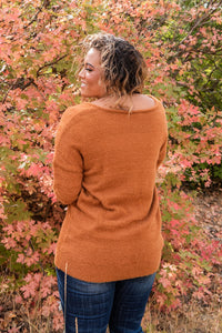 "soft and fuzzy fabric, this fuzzy v-neck sweater in the color ""camel"". Features: Long sleeve v-neck fuzzy sweater.  Fabric: 100% Acrylic  Approx Measurements:  Small: Bust 44"", Length 26""  Medium: Bust 45"", Length 26""  Large: Bust 47"", Length 27"""