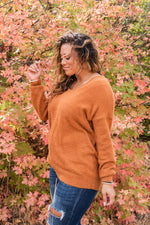 "Load image into Gallery viewer, soft and fuzzy fabric, this fuzzy v-neck sweater in the color ""camel"". Features: Long sleeve v-neck fuzzy sweater.  Fabric: 100% Acrylic  Approx Measurements:  Small: Bust 44"", Length 26""  Medium: Bust 45"", Length 26""  Large: Bust 47"", Length 27"""
