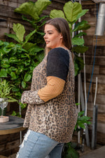 "Load image into Gallery viewer, This longsleeve leopard print top features a color block print on the sleeves with black, gold with stripes and leopard.  Fabric: 95% Polyester, 5% Spandex  Approx Measurements:  1X: Bust 46"", Length 29""  2X: Bust 48"", Length 39""  3X: Bust 50"", Length 25  Model Kendall: 5'5 size 16 wearing size 2X"