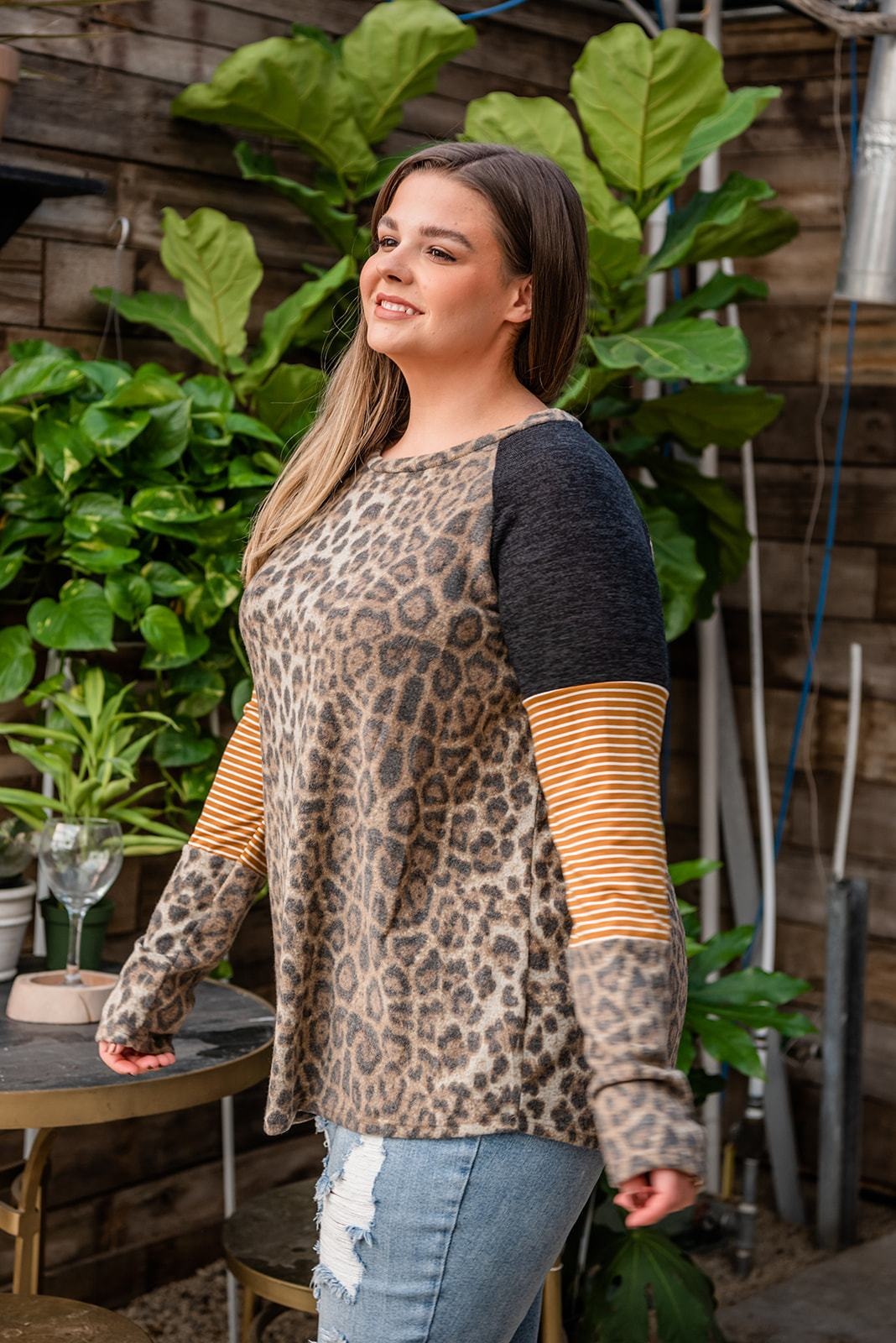 "This longsleeve leopard print top features a color block print on the sleeves with black, gold with stripes and leopard.  Fabric: 95% Polyester, 5% Spandex  Approx Measurements:  1X: Bust 46"", Length 29""  2X: Bust 48"", Length 39""  3X: Bust 50"", Length 25  Model Kendall: 5'5 size 16 wearing size 2X"