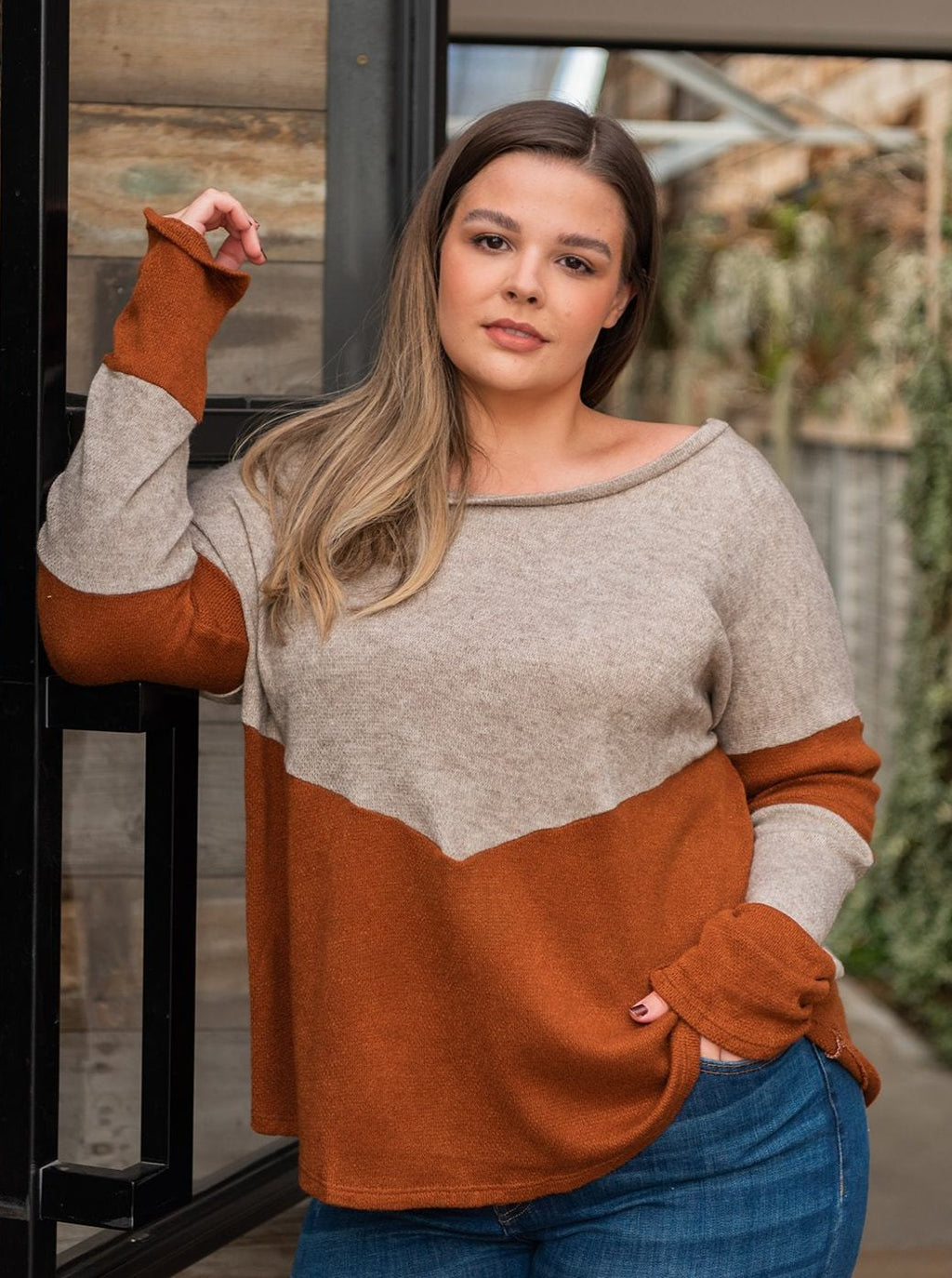"This top features: Rust and Oatmeal Two toned color-block top with long sleeves, round neckline. Fabric: 95% Polyester, 5% Spandex  Approx Measurements:  Small: Bust 41"", Length 26""  Medium: Bust 42"", Length 26 1/2""  Large: Bust 43"", Length 27""  XLarge: Bust 44"", Length 28""  1X: Bust 48"", Length 27""  2X: Bust 50"", Length 27""  3X: Bust 52"", Length 27""   Model Kendall: 5'7 size 16 wearing size 2X"
