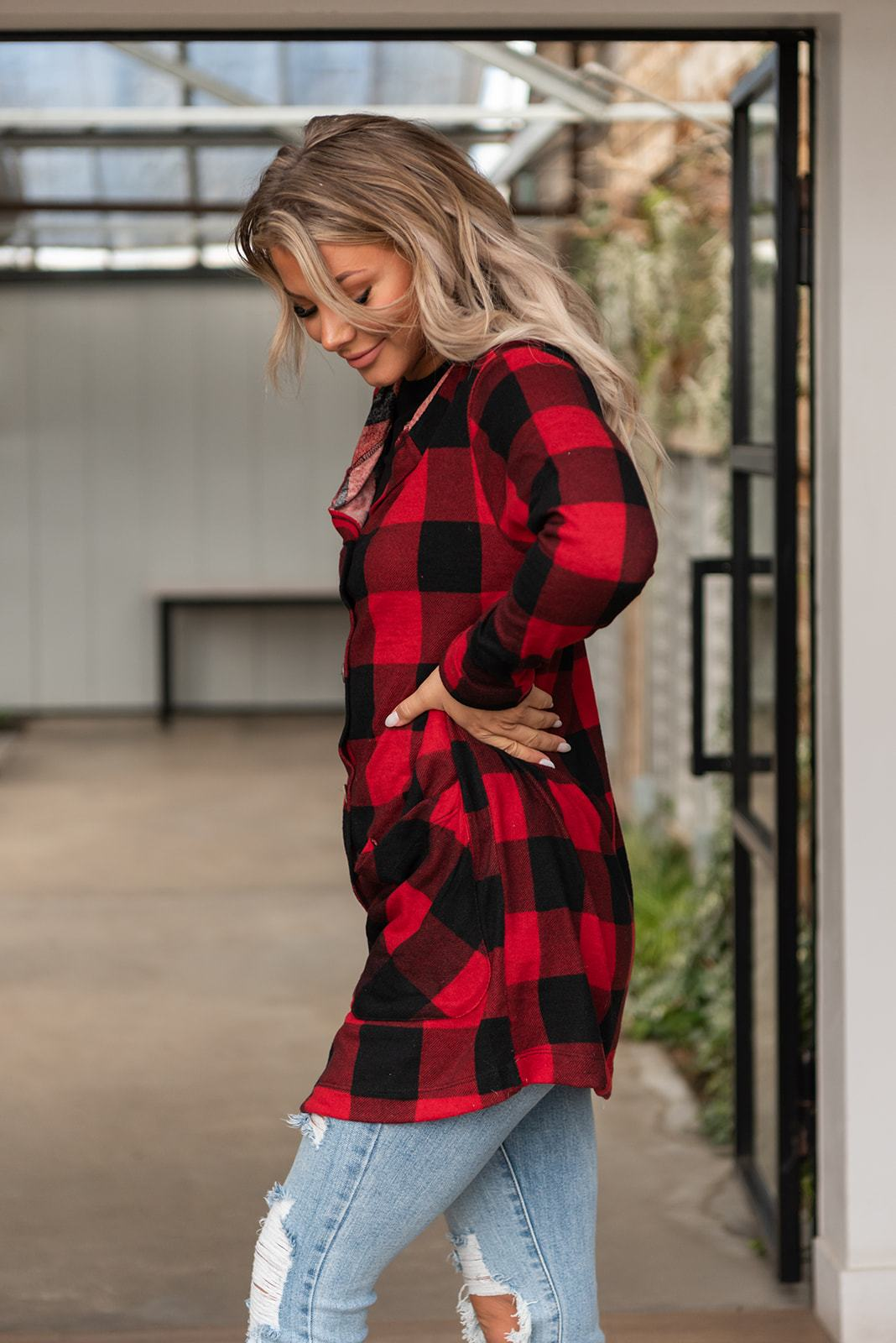 "Features: Buffalo plaid printed cardigan with button up front, pockets and hood. Runs true to size.  Fabric: 96% Polyester, 4% Spandex  Approx Measurements:  Small: Bust 40"", Length 33""  Medium: Bust 42"", Length 33""  Large: Bust 44"", Length 34""  Model Cassidy: 5'7 size 2/3 wearing size Small"
