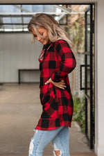 "Load image into Gallery viewer, Features: Buffalo plaid printed cardigan with button up front, pockets and hood. Runs true to size.  Fabric: 96% Polyester, 4% Spandex  Approx Measurements:  Small: Bust 40"", Length 33""  Medium: Bust 42"", Length 33""  Large: Bust 44"", Length 34""  Model Cassidy: 5'7 size 2/3 wearing size Small"