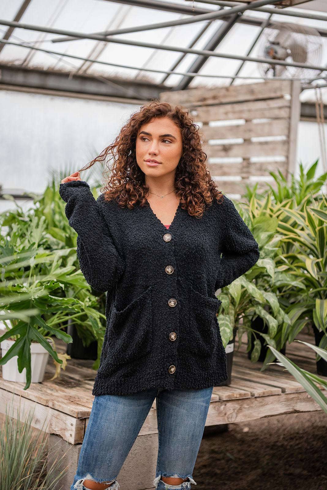 "Black Popcorn Cardigan Hoodie with a button front and pockets.   Fabric: 50% Acrylic 50% Polyester  Approx Measurements:  Small: Bust 42"", Length 29""  Medium: Bust 46"", Length 29""  Large: Bust 48"", Length 29""  1X; Bust 52"", Length 29""  2X: Bust 53"", Length 31""  3X: Bust 54"", Length 32""  Model Paityn: 5'7 size 2/3 wearing size Small"