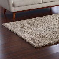 FLATTE SOLID 8X10 SHAG AREA RUG IN BEIGE AND IVORY