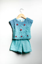 Smocking Top Paired With Shorts