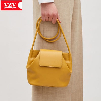 Young girl sac 2019 new summer female niche design minimalist personality yellow shoulder slung soft bucket bag Bolso Mujer