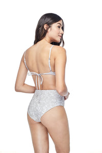 Ozero Swimwear Caspian High-Waisted Bikini Set in exclusive textile print, worn by a model, back view, designed in Malaysia by Russian designer.