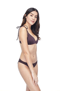 Ozero Swimwear Como minimal Bikini Set in Dark Brown, on a model, side view, sustainable fabrics, made in Bali.