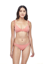 Ozero Swimwear Como minimal Bikini Set in Dusty Coral, on a model, front view, sustainable fabrics, made in Bali.
