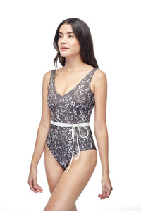 Ozero Swimwear Geneva One-Piece Swimsuit in exclusive textile print, with belt, worn by model, side view, Italian Lycra, designed in Malaysia.