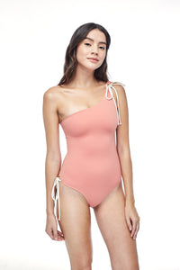 Ozero Swimwear Rotorua One-Piece Swimsuit in Dusty Coral, worn by model, front view, made in Bali from sustainable fabrics.
