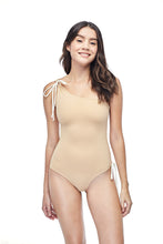 Ozero Swimwear Rotorua One-Piece Swimsuit, worn by model on reversible side in Beige color, made in Bali from sustainable fabrics.