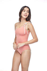 Ozero Swimwear Rotorua One-Piece Swimsuit in Dusty Coral, worn by model, side view, made in Bali from sustainable fabrics.