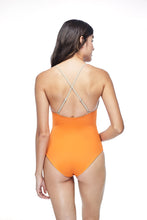 Ozero Swimwear Seliger  classic cut One-Piece Swimsuit in Burnt Orange, worn by model, back view, made in Bali from sustainable fabrics.