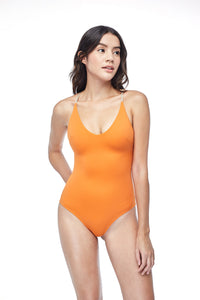 Ozero Swimwear Seliger  classic cut One-Piece Swimsuit in Burnt Orange, worn by model, front view, made in Bali from sustainable fabrics.