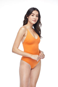 Ozero Swimwear Seliger  classic cut One-Piece Swimsuit in Burnt Orange, worn by model, side view, made in Bali from sustainable fabrics.