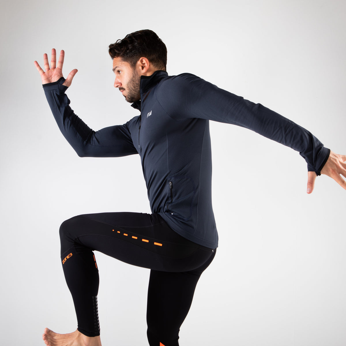 Men's Performance Culture Long Sleeve Mid Layer with 1/4 length Zip pose