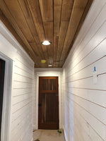 hallway with barn wood ceiling planks