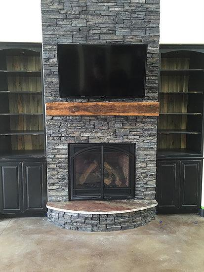 Simple reclaimed wood mantle over fireplace
