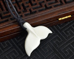 Load image into Gallery viewer, yak bone carved white whale tail pendant